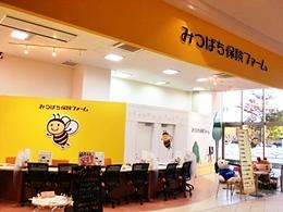 みつばち保険ファーム イオンモール日の出店のロゴ